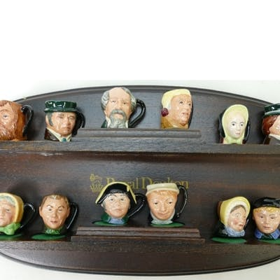 A complete set of Royal Doulton Dickings tiny character jugs...