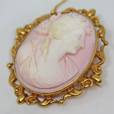 A pink and white cameo brooch, mounted in hallmarked 9ct gol...