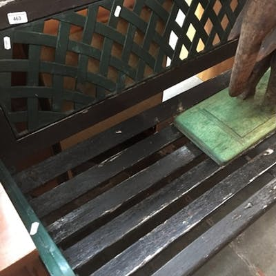 A wooden and cast metal garden bench, length 128cm.