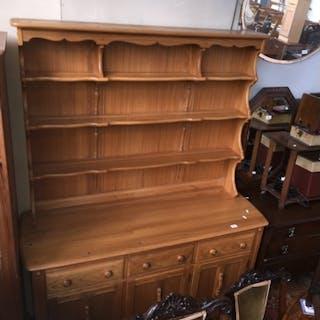 An Ercol light elm dresser, height 192cm, width 146cm.