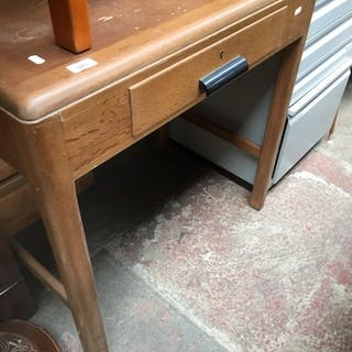 A small oak writing table with drawer