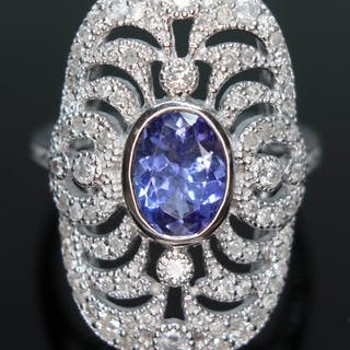 An 18ct white gold sapphire and diamond cluster ring, the ov...