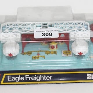 A boxed Dinky Toys die cast Eagle Freighter no. 360 from Ger...