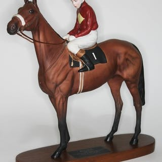 A Beswick model Red Rum and rider on wooden base, height 33c...