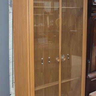 An Ercol blonde elm glazed display cabinet bookcase, width 9...