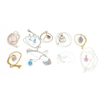 Ten silver semi precious stone pendants on chains, approxima...