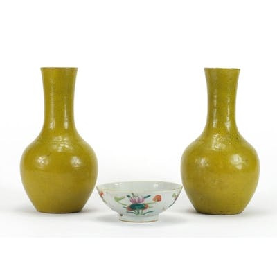 Pair of Chinese yellow glazed vases and a famille rose foote...