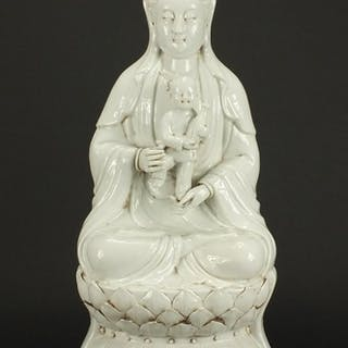 Large Chinese Blanc de Chine porcelain figure of Guanyin hol...