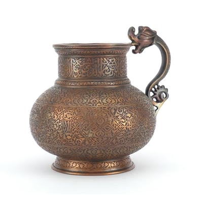 Good Persian copper jug with dragon handle, the body finely ...