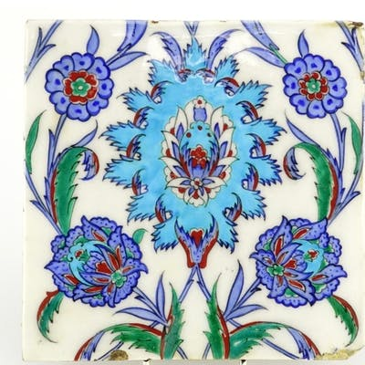Turkish Kutahya tile hand painted with flowers and foliage, ...