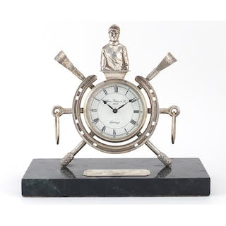 Silver horse riding trophy clock, raised on a green marble b...