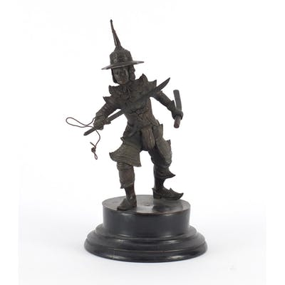 Thai patinated bronze warrior raised on circular ebonised st...