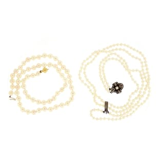 Single string pearl necklace with 18ct gold clasp and a doub...