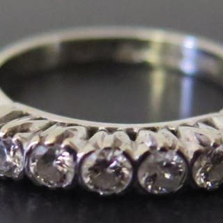 An 18ct White Gold and Diamond Seven Stone Ring, size L, 3.9...