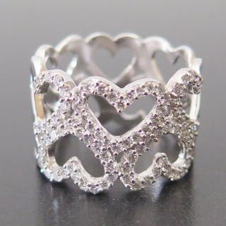 An 18ct White Gold and Diamond Heart Ring, size S.5 to centr...