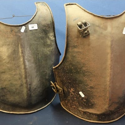 Two steel reproduction breast plates with strap mounts