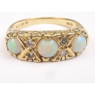 Opal three stone ring with small eight cut diamonds in 18ct ...