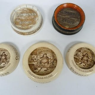 Five Guinness advertising pottery ashtrays, two in the form ...