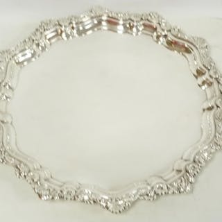 Old Sheffield plated circular tray with shaped scroll and sc...