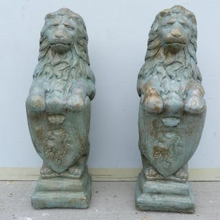 Pair of garden lions, later painted silver, 82cm high, (one ...