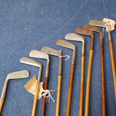 Nine hickory shafted golf clubs including: Schneider, stainl...