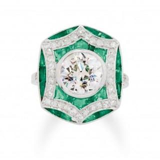 An Art Deco Diamond, Emerald and Platinum Ring, circa 1920