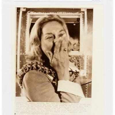 "AP Original Wirephotos: ""Husband's Greeting Breaks Her Up"" July 27"