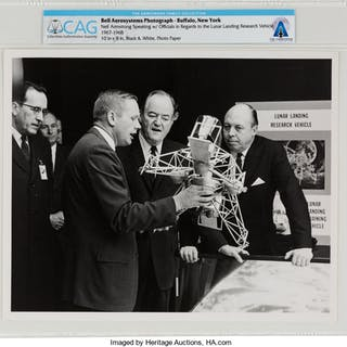 Bell Aerosystems Photograph of Neil Armstrong Speaking with Officials