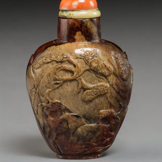 A Chinese Carved Mottled and Russet Jade Snuff Bottle, 19th century