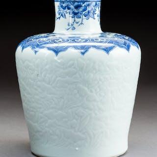 A Chinese Blue and White Molded Porcelain Vase, Qing Dynasty, Kangxi
