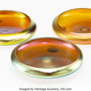 A Group of Three Steuben Gold Aurene Glass Center Bowls, circa 1910