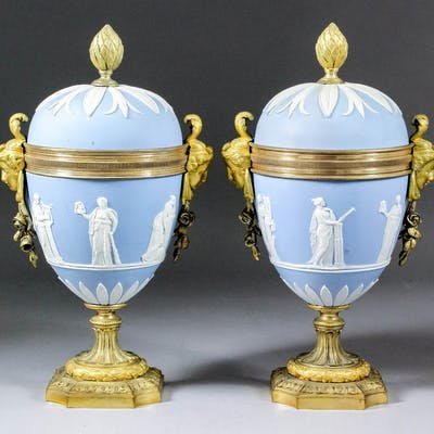 A Pair of ormolu mounted Wedgwood blue Jasperware urns with covers