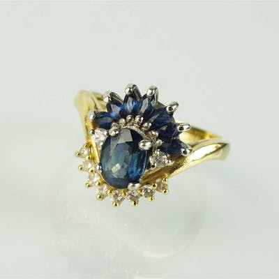 An 18ct gold sapphire and diamond cluster ring
