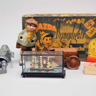A collection of vintage toys including a Tri-Ang tractor