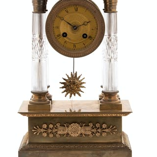 A Charles X Gilt Bronze and Crystal Portico Clock