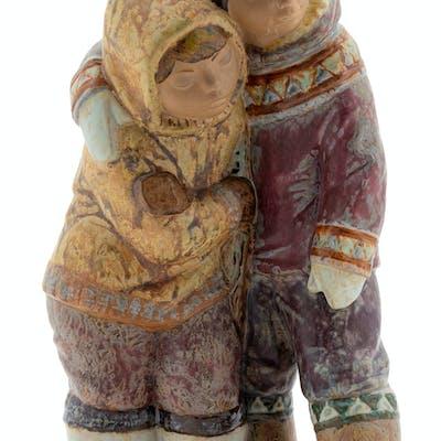 A Lladro Porcelain Figural Group