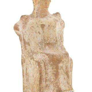 A Greek Terra Cotta Seated Female Figure