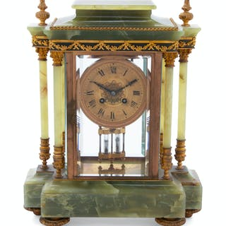 A French Gilt Bronze Mounted Onyx Mantel Clock