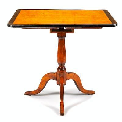 A Biedermeier Style Parcel Ebonized Table
