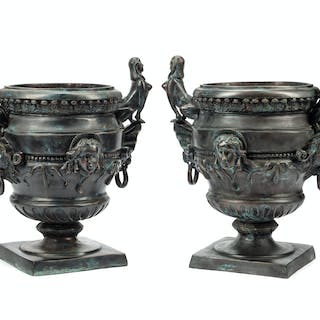 A Pair of Egyptian Revival Patinated Metal Planters