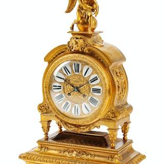 A Régence Style Gilt Bronze Clock