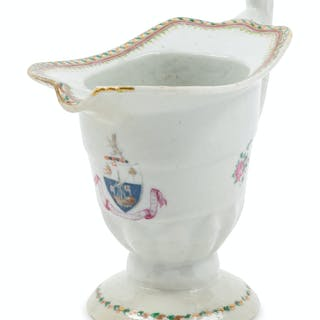 A Chinese Export Armorial Porcelain Creamer