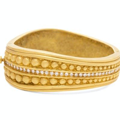An 18 Karat Yellow Gold and Diamond Bangle Bracelet