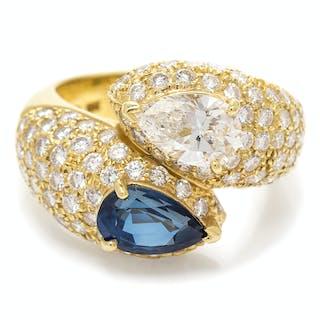 A Vintage 18 Karat Yellow Gold, Sapphire and Diamond Bypass Ring, Cartier