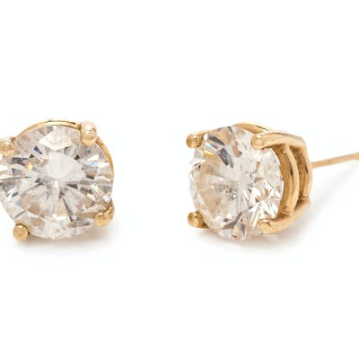 A Pair of Yellow Gold and Diamond Stud Earrings