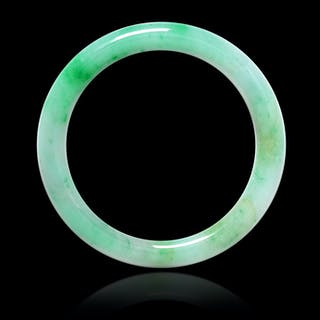 An Apple Green and Celadon Jadeite Bangle