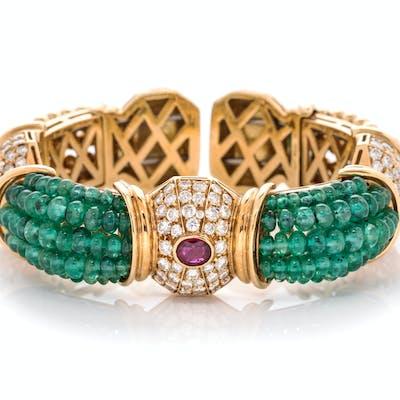 An 18 Karat Yellow Gold Diamond, Ruby and Emerald Cuff Bracelet