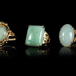 Three Jadeite and 14K Yellow Gold Mounted Rings
