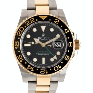 Rolex, Stainless Steel and 18K Yellow Gold Ref. 116713 'GMT Master