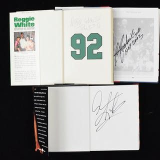 Lot of (11) signed sports books including Reggie White...